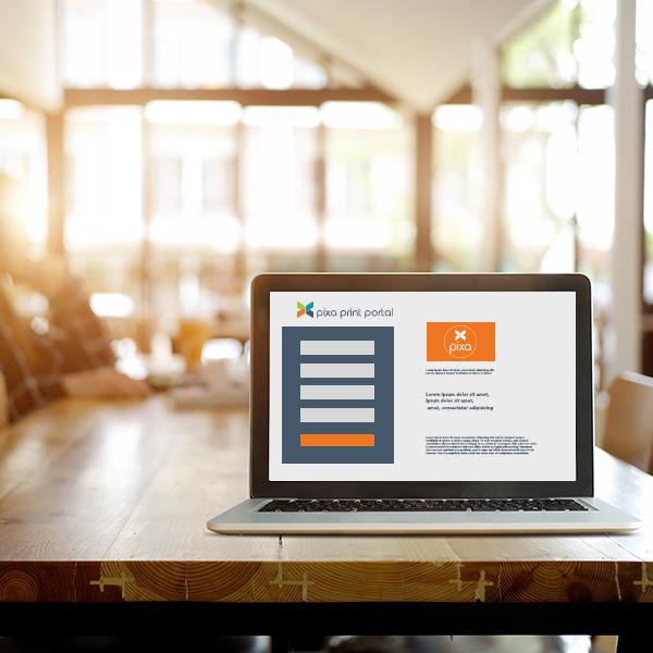 laptop on desk showing Pixa Print Portal